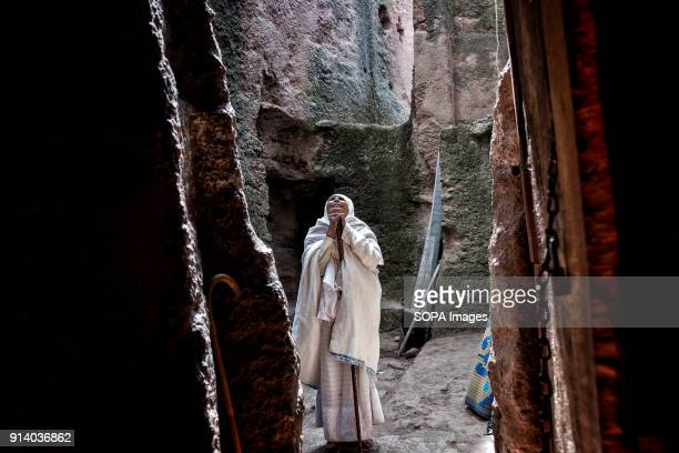 A woman praying at the entrance of the Biete Denagel During the first days of January thousands of Ethiopian Orthodox Christian pilgrims go to the...
