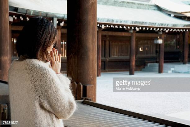 A woman praying in a temple