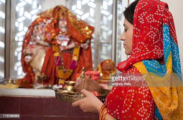 woman praying in a temple, sohna, haryana, india - god stock pictures, royalty-free photos & images