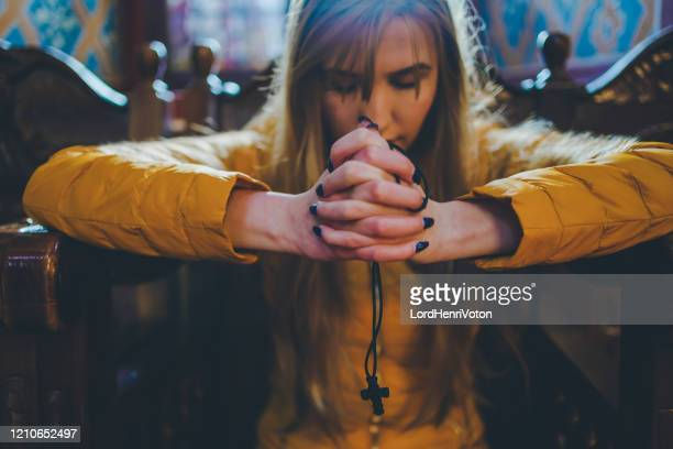woman praying in church - orthodox church stock pictures, royalty-free photos & images