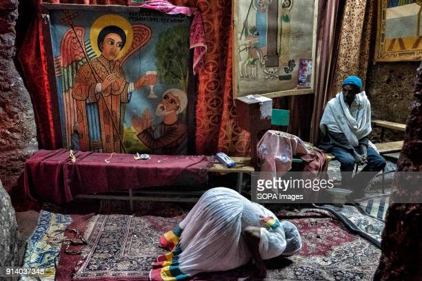 A woman praying inside a church in Lalibela During the first days of January thousands of Ethiopian Orthodox Christian pilgrims go to the city of...