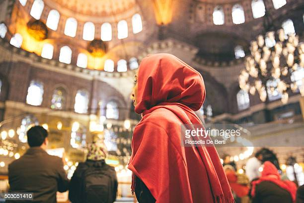 woman praying inside a mosque - muslim praying stock pictures, royalty-free photos & images