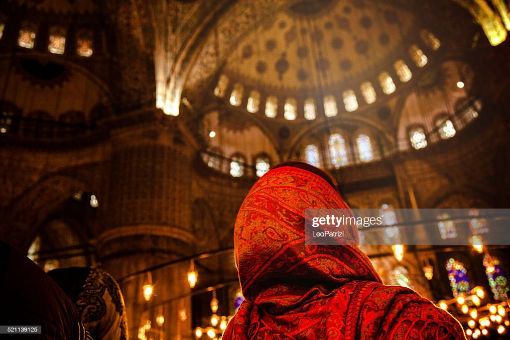 Woman praying inside a mosque : Stock Photo