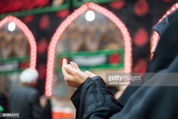woman praying inside a mosque - shrine of the imam ali ibn abi talib stock pictures, royalty-free photos & images