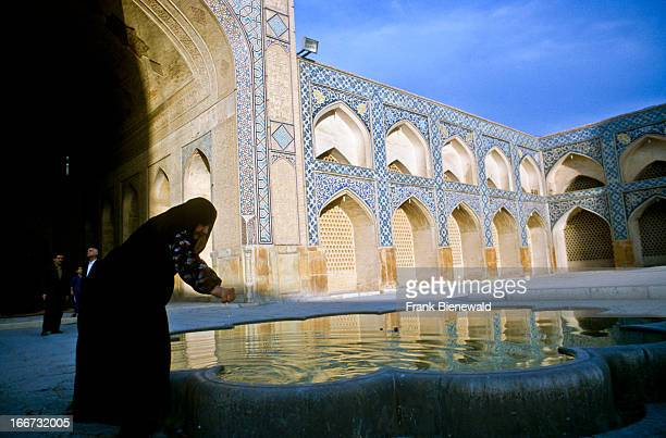 Woman praying inside of ImamMosque