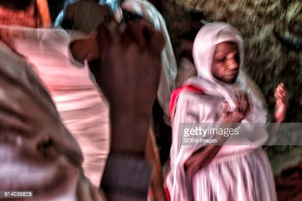 A woman praying inside the Biete Denagel in Lalibela During the first days of January thousands of Ethiopian Orthodox Christian pilgrims go to the...