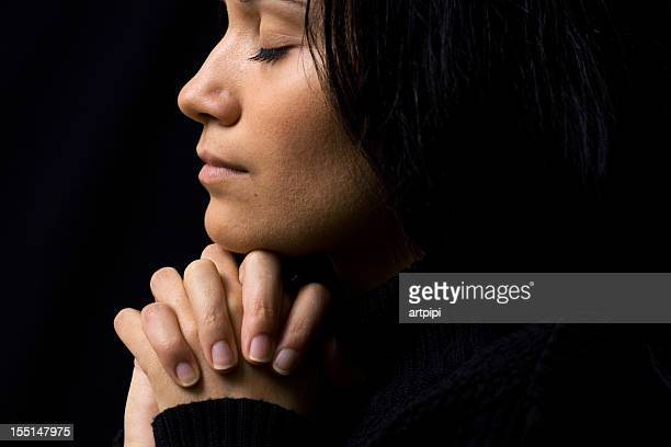 woman praying - christianity stock pictures, royalty-free photos & images