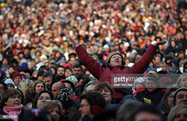 A woman prays as gospel music is sung during the sixtythird annual Easter Sunrise Service at Red Rocks Amphitheatre on April 4 2010 in Morrison...