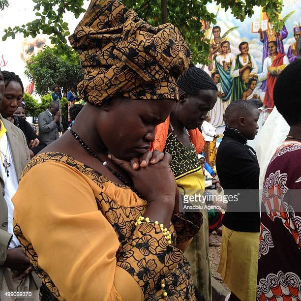 A woman prays as she attends a Mass for the martyrs of Uganda celebrated by Pope Francis near the Catholic shrine of Namugongo in Kampala Uganda on...