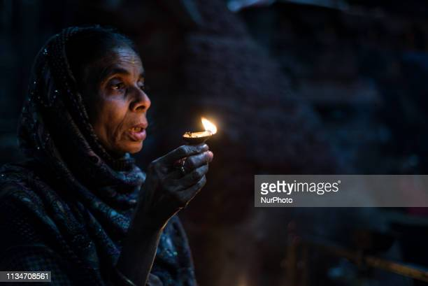 A woman prays at a Hindu temple in Thamel district Kathmandu Nepal on April 3 2019