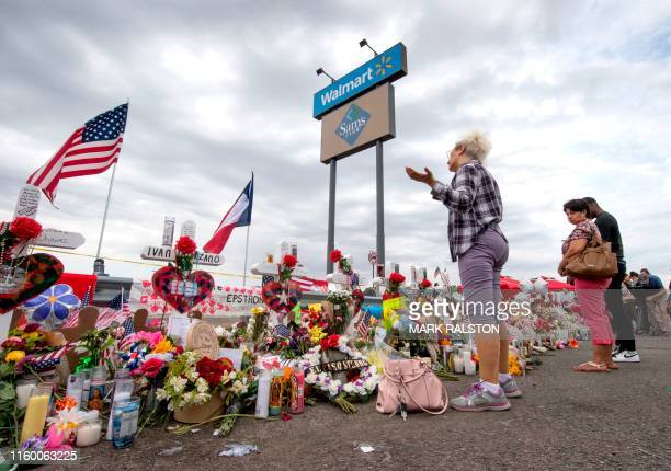 A woman prays at a makeshift memorial for shooting victims at the Cielo Vista Mall Walmart in El Paso Texas on August 6 2019 The August 3 shooting...