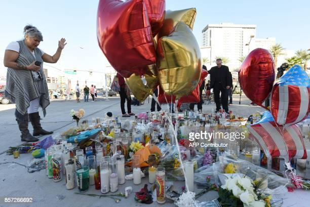 A woman prays at a makeshift memorial on the Las Vegas Strip in Las Vegas Nevada on October 3 after a gunman killed 59 people and wounded more than...