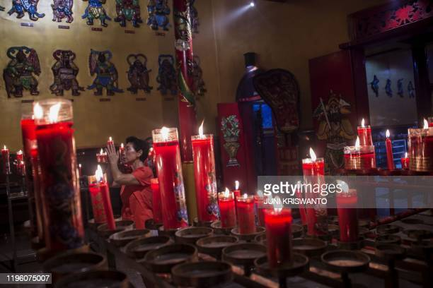 A woman prays at a temple on the first day of the Lunar New Year in Surabaya on January 25 2020