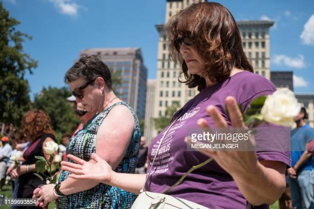 Woman prays at a vigil held in honour of those who lost their lives during a shooting in Dayton, Ohio on August 04, 2019. - Nine people were killed...