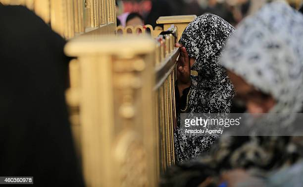 A woman prays at Abbas ibn Ali shrine during the Arba'een ceremony in Islamabad Pakistan on December 12 2014 Hundreds of Shiite worshippers attend...