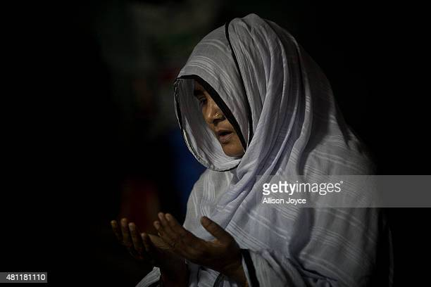A woman prays at Baitul Mukarram the National Mosque on Eid AlFitr July 18 2015 in Dhaka Bangladesh Muslims around the world are celebrating Eid...