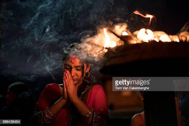 A woman prays at Pashupatinath an important Shiva temple on September 4 2016 in Kathmandu Nepal Teej Festival is celebrated by Hindu women across...