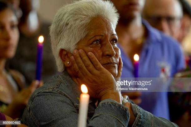 A woman prays at San Lazaro church on December 16 2017 in La Habana Cuba Thousands of believers gather at the Shrine of San Lazaro on the outskirts...