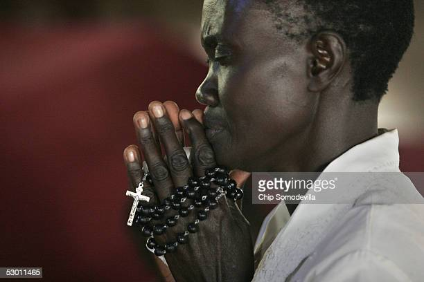 A woman prays at the Catholic Basilica Church of the Uganda Martyrs a day before the Ugandan national Martyrs Day holiday on June 2 2005 in Namugongo...