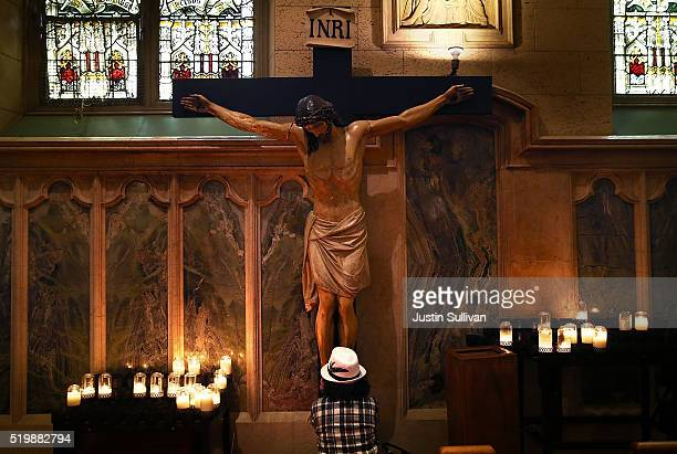 Woman prays at the foot of a statue of Jesus Christ inside St. Patrick Church on April 8, 2016 in San Francisco, California. Pope Francis released a...
