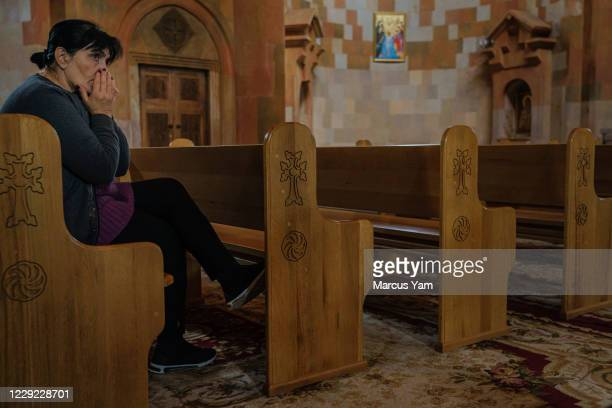 Woman prays at the Holy Mother of God Cathedral in Stepanakert, Nagorno-Karabakh, which is also internationally recognized as part of Azerbaijan, on...