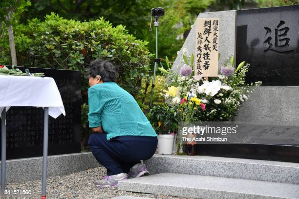 A woman prays at the memorial for the Korean victims of the Great Kanto Earthquake at Yokoami Park on September 1 2017 in Tokyo Japan National...