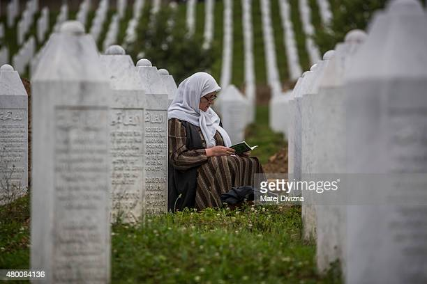 A woman prays at the Potocari cemetery and memorial near Srebrenica on July 9 2015 in Srebrenica Bosnia and Herzegovina The newlyidentified remains...