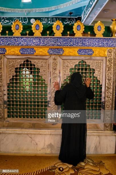 A woman prays at the tomb of two brothers Sayed Issa Barzanji and Sayed Moussa Barzanji descendants of Baba Tahir Hamadani