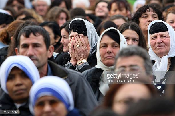 A woman prays during a ceremony of canonization of 38 martyrs of the catholic church in the town of Shkoder on November 5 2016 Thousands of pilgrims...