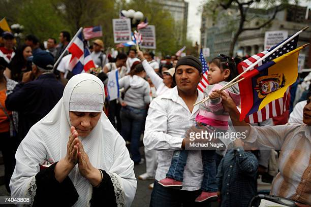 A woman prays during an immigration reform rally in Union Square on May 1 2007 in New York City The protest was one of many held around the country...