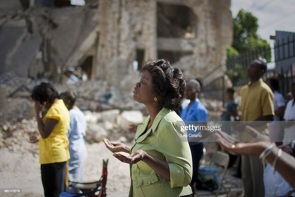 Image result for haiti 2010 earthquake cathedral people praying