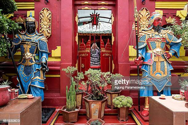 A woman prays during preparations for the upcoming Chinese New Year at Dwipayana Tanah Kilap Temple on January 25 2014 in Denpasar Bali Indonesia...