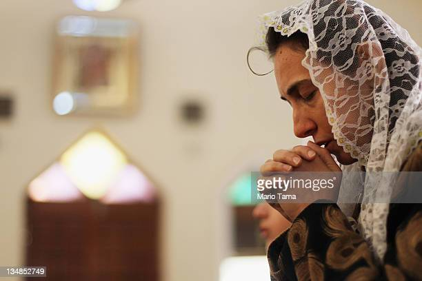 A woman prays during services at Saint Mary of Rosary Catholic Church on December 4 2011 in Baghdad Iraq Forming one of the oldest Christian...