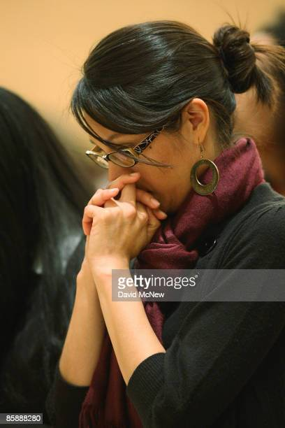 Woman prays during the celebration of the Mass of the Lord's Supper, where Cardinal Roger Mahony washed the feet of 12 people, following the example...