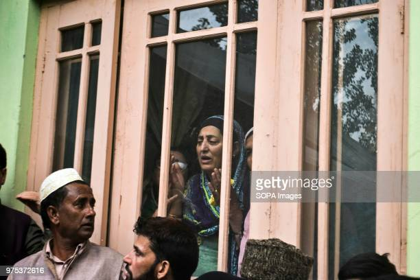 A woman prays during the funeral procession of Shujaat Bukhari veteran journalist and EditorinChief of English daily 'Rising Kashmir' in Kreeri some...