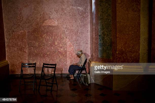 A woman prays during the pilgrimage to the Jasna Gora monastery on August 15 2015 in Czestochowa Poland Hundreds of thousands make the annual...