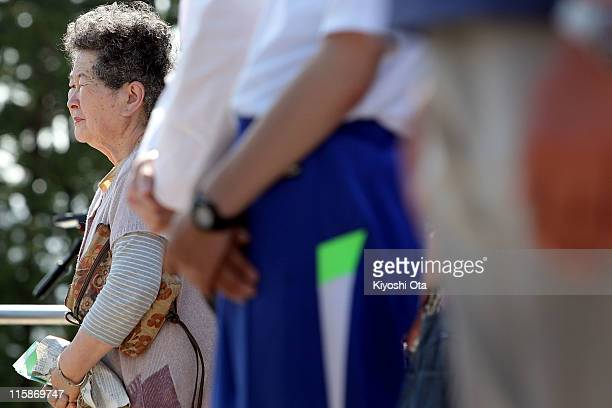 A woman prays for the earthquake and tsunami victims on June 11 2011 in Minamisanriku Miyagi Japan The Japanese government has been struggling to...