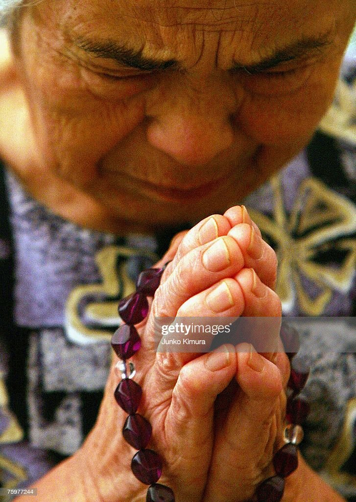 A woman prays for the victims of the atomic bomb on August 6, 2007 in Hiroshima. Japan. The dropping of the atomic bomb by the U.S. killed an estimated 70,000 people instantly on August 6, 1945 with many thousands more dying over the following years from the effects of radiation. Three days later another atomic bomb was dropped on Nagasaki, ending World War II.