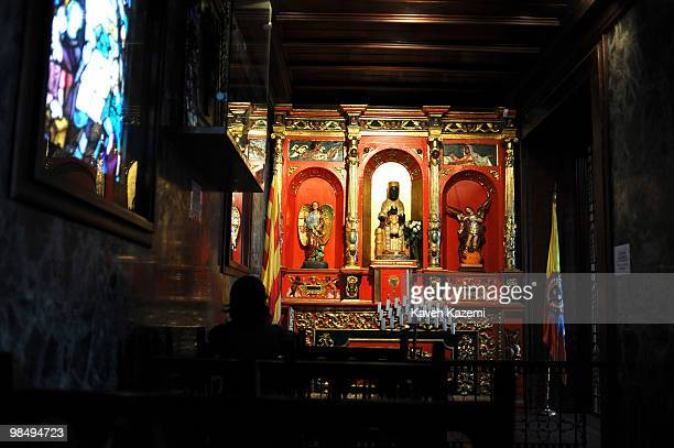 A woman prays in a chapel in front of a statue of Virgin Mary depicted as Black Maddona inside Monserrate church Monserrate has held religious...