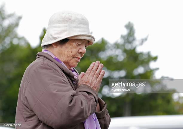 A woman prays in front of an evacuation center in Atsuma Hokkaido on Sept 13 one week after a strong earthquake struck Japan's northernmost main...
