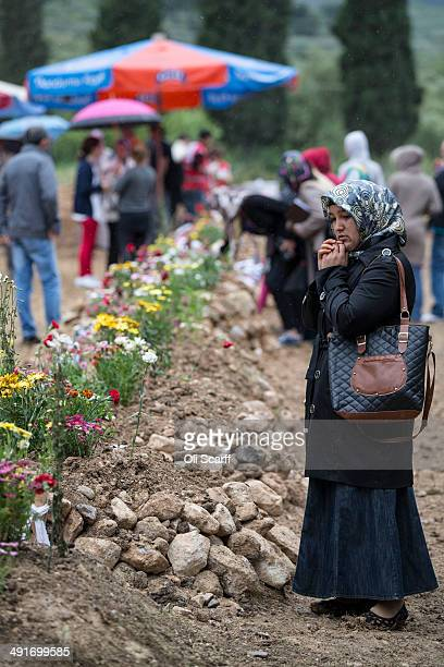 A woman prays in Soma cemetery at the grave of a miner who died in an explosion at the Soma mine following the burial of further bodies recovered...