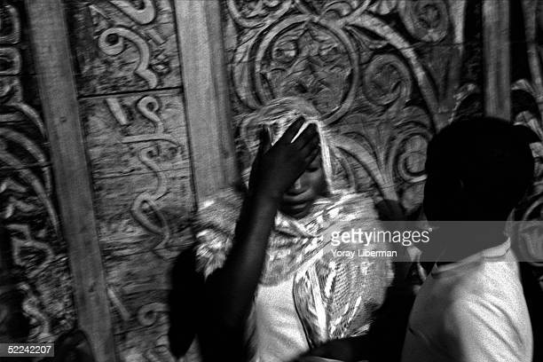 Woman prays near the entrance of the mosque of Touba on April 23 2003 in Touba Senegal The Mouride Baye Fall community in Senegal celebrates the...