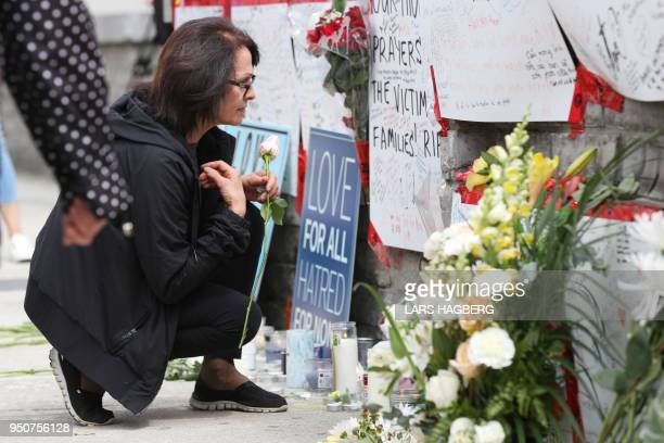 A woman prays on April 24 2018 at a makeshift memorial for victims in the van attack in Toronto Ontario A van driver who ran over 10 people when he...