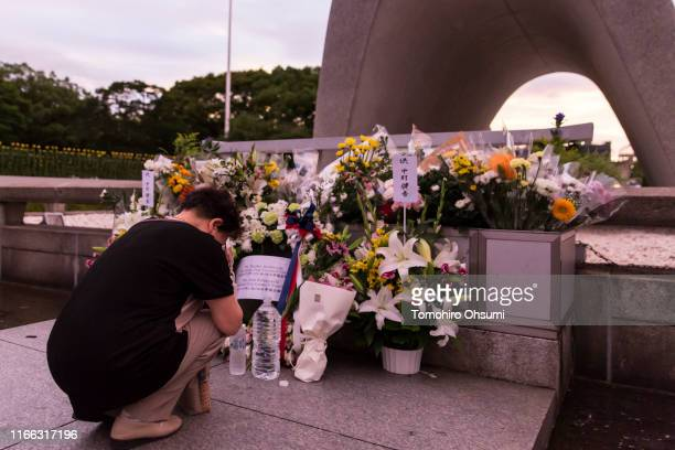 A woman prays on the 74th anniversary of the atomic bombing of Hiroshima at the Hiroshima Peace Memorial Park on August 6 2019 in Hiroshima Japan...