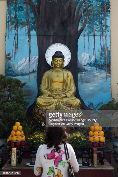 Woman prays outside the Chua Dieu Ngu Buddhist Temple during a human rights conference to discuss issues in Tibet and Vietnam in Westminster, CA on...