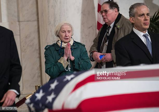 A woman prays over the casket of US Supreme Court Justice Antonin Scalia at the Supreme Court in Washington DC on February 19 2016 where it will lie...