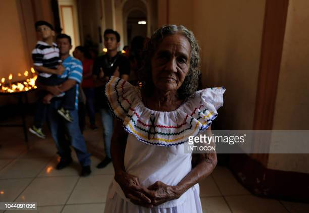 A woman prays to San Jeronimo in San Jeronimo Church during celebrations of San Jeronimo the patron saint of Masaya in Masaya some 30 km from Managua...
