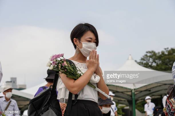A woman prays while wearing a face mask at the Hiroshima Peace Memorial Ceremony Hiroshima marks the 75th anniversary of the US atomic bombing which...
