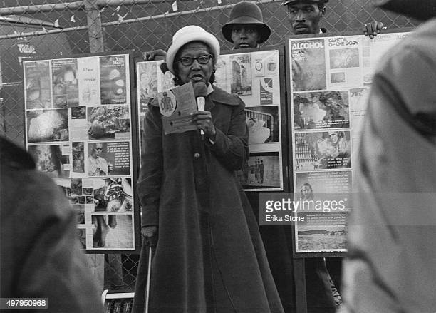 A woman preaching against the evils of alcohol on 42nd Street New York City circa 1970