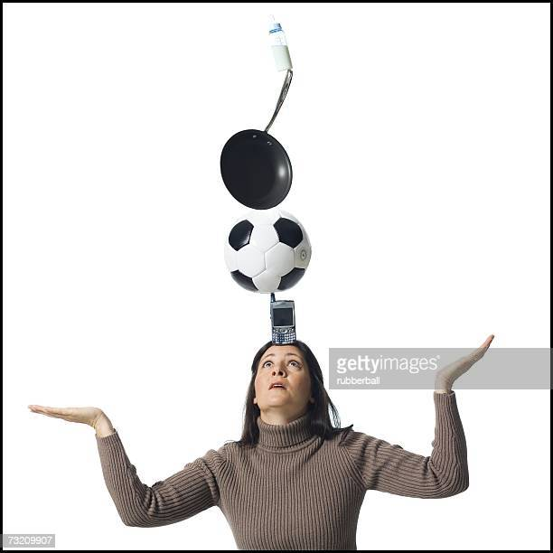 Woman precariously balancing items on her head